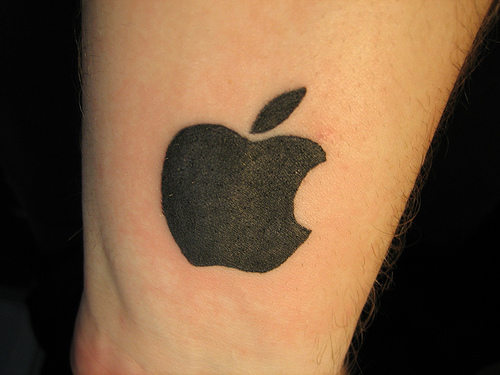 Apple logo tattoo.